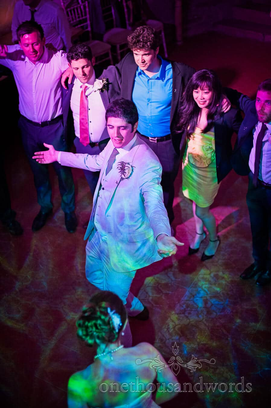 Groom dances at bride in Porth en Alls, Cornwall