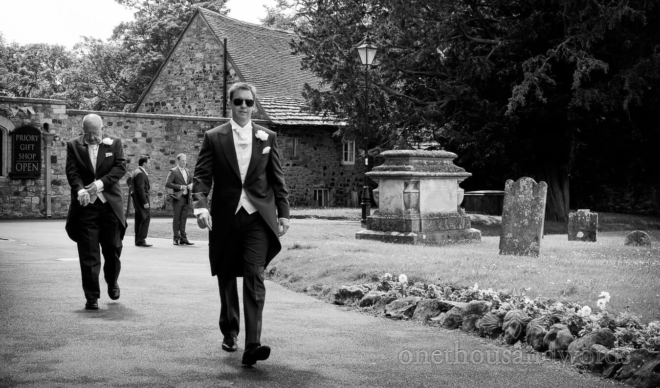 Groom in sunglasses at Christchurch Priory wedding