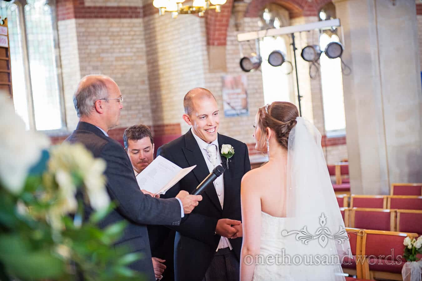 Groom making vows in church wedding ceremony in Poole