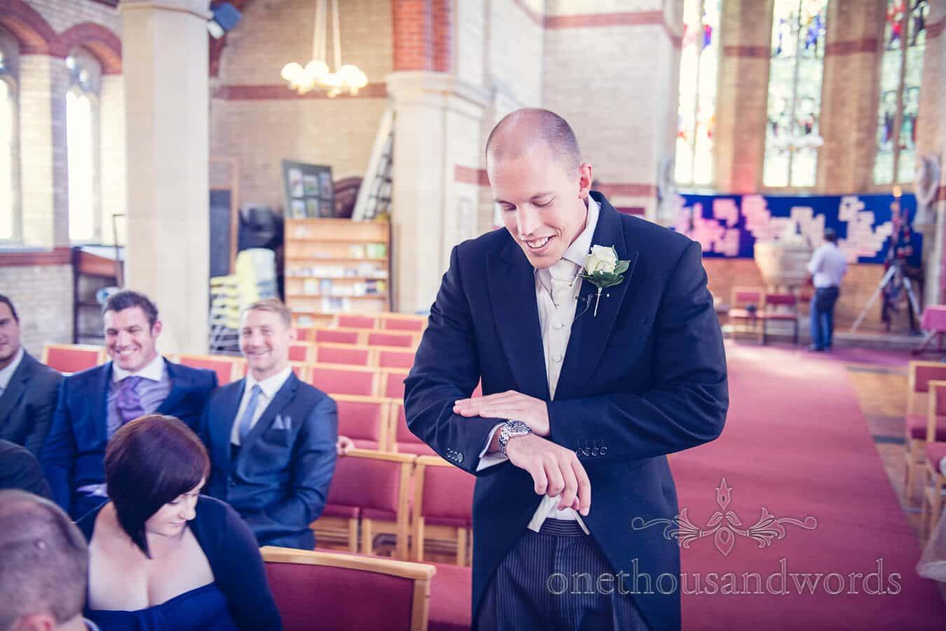 Groom nervously awaits bride at Poole wedding venue church