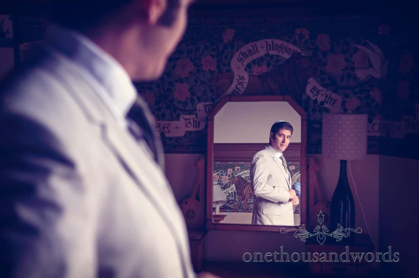 Groom portrait photograph in mirror at Prussia Cove Wedding venue