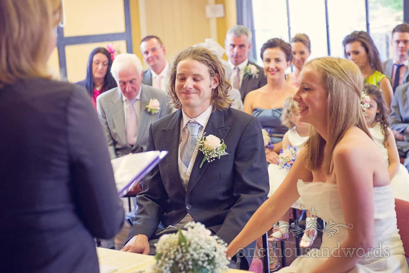 Groom smiles during Tenbury Wells Pump Rooms Wedding Ceremony