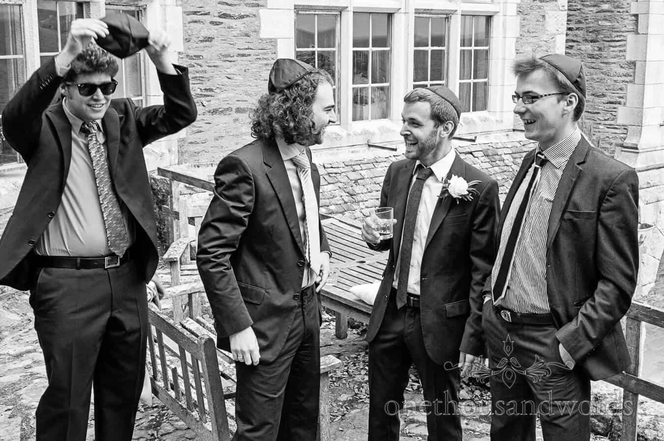 Groomsmen put on their kippas for Jewish wedding cermony