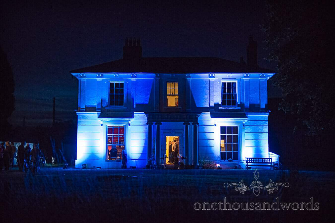 Home Countryside Wedding Venue uplit in blue at night