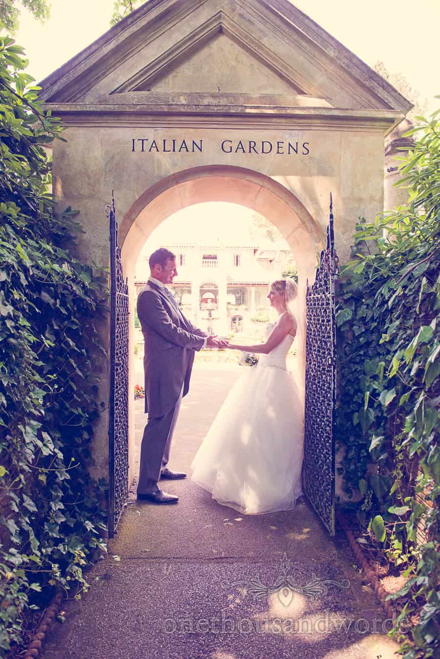 Italian Villa Wedding venue Photographs of bride and groom under archway