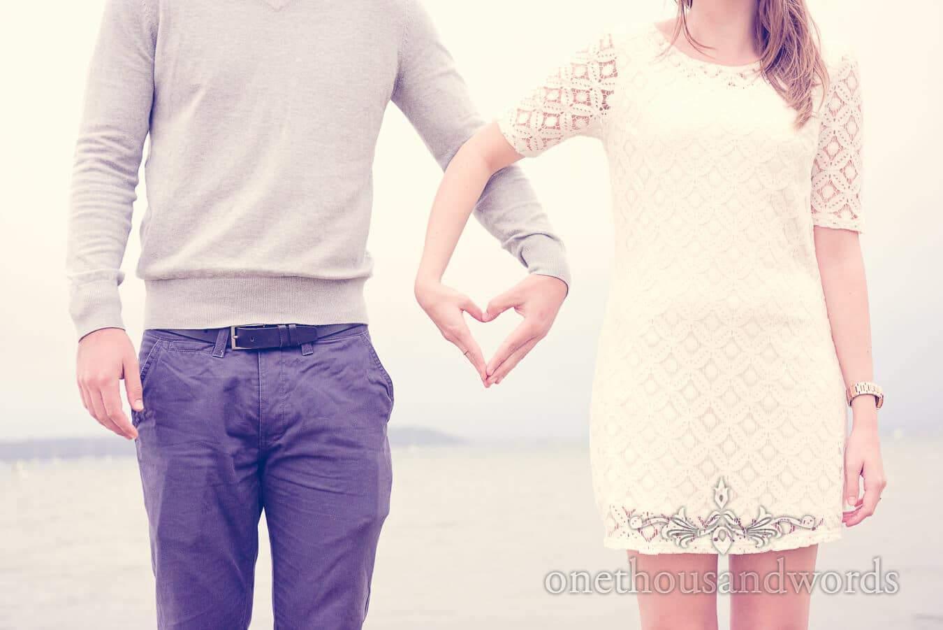 Love heart hands at Sandbanks Hotel Engagement Photographs