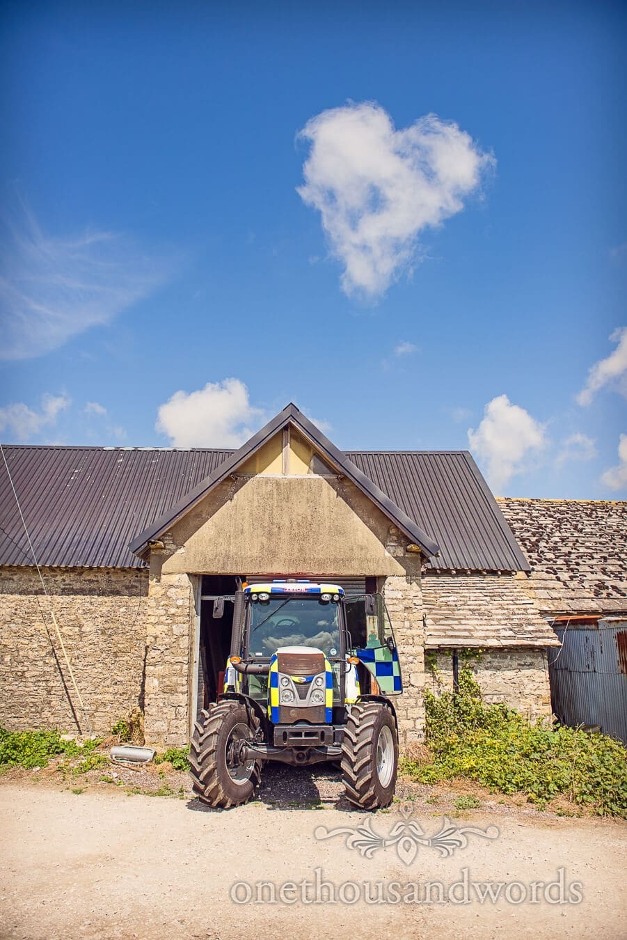 Love heart shaped cloud with police tractor at Dorset home wedding