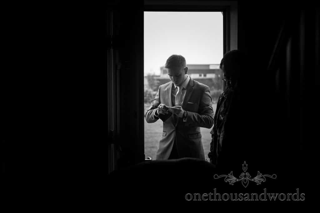 Black and white photograph of groom on wedding morning in Dorset