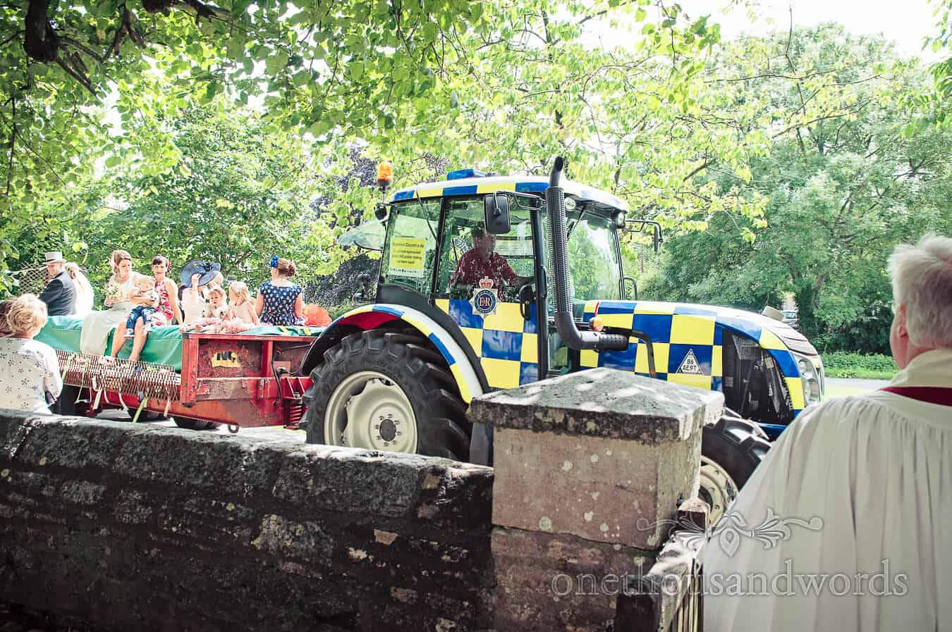 Police tractor pulls wedding guests to countryside church on trailer