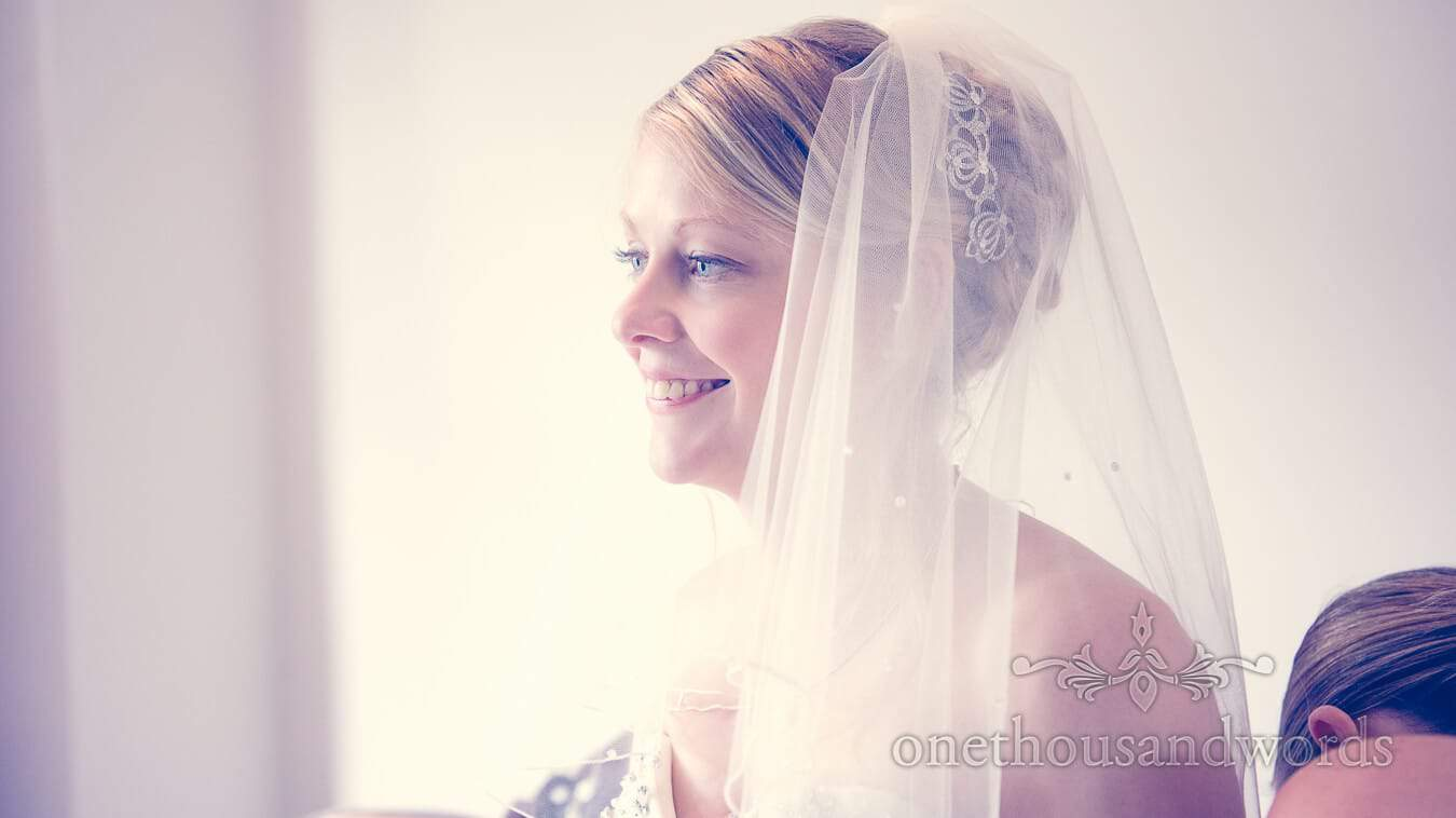 Portrait of bride in wedding veil on wedding morning