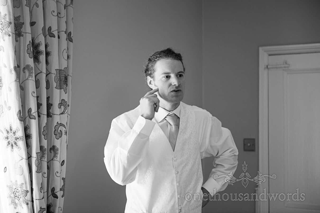Portrait photograph of groom lost in thought on Countryside Wedding morning