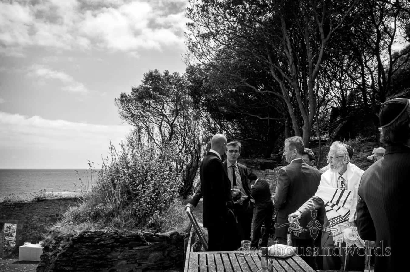 Rabbi at jewish wedding by the sea in Cornwall