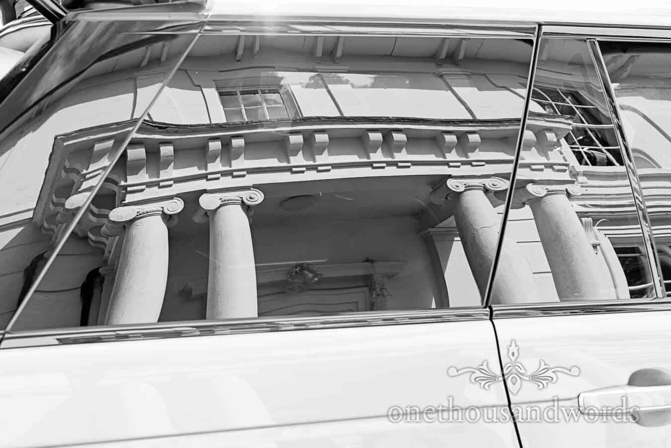 Reflection of Countryside house Wedding venue in wedding car window