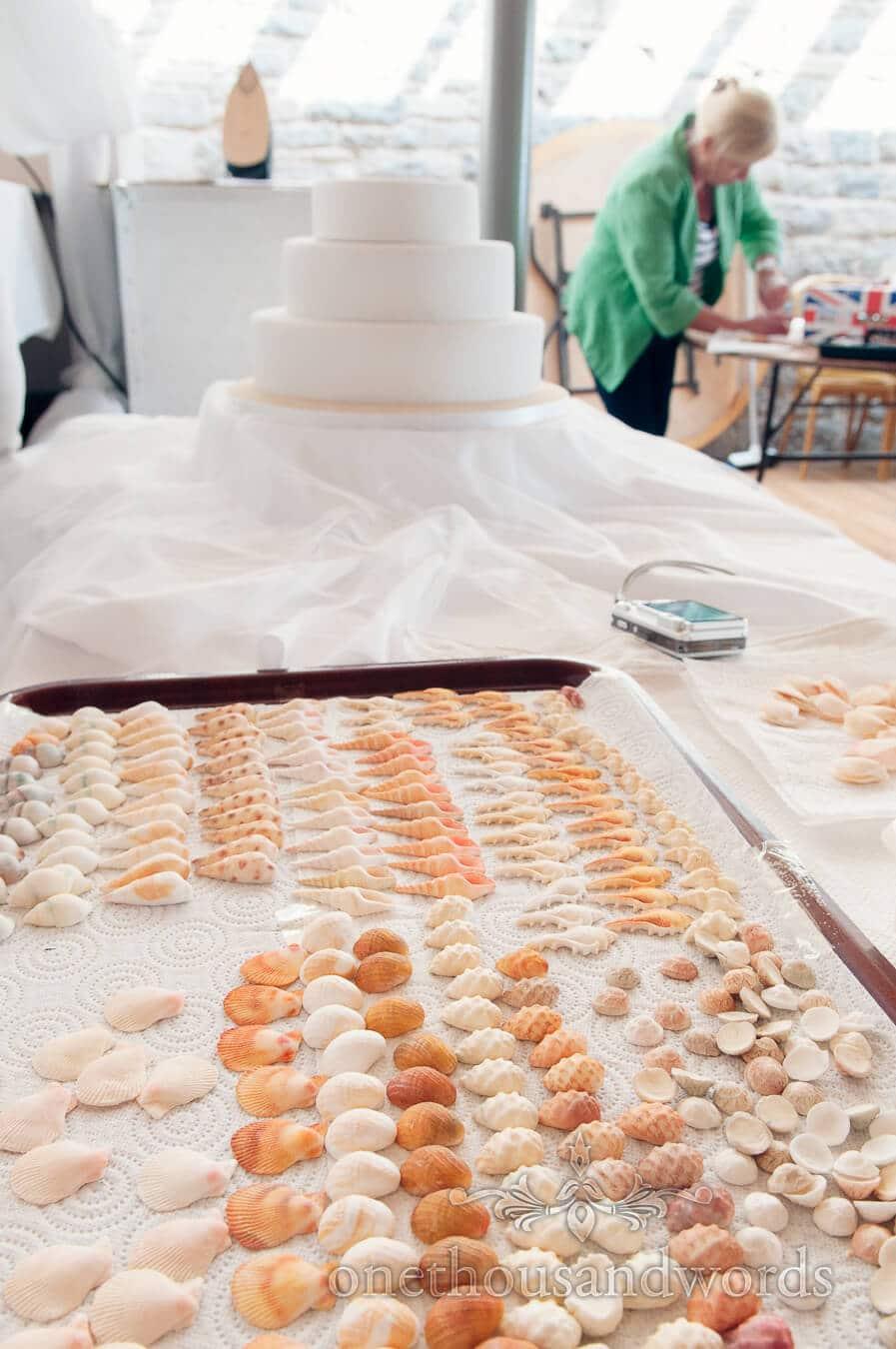 Seaside wedding cake is prepared with edible sea shells