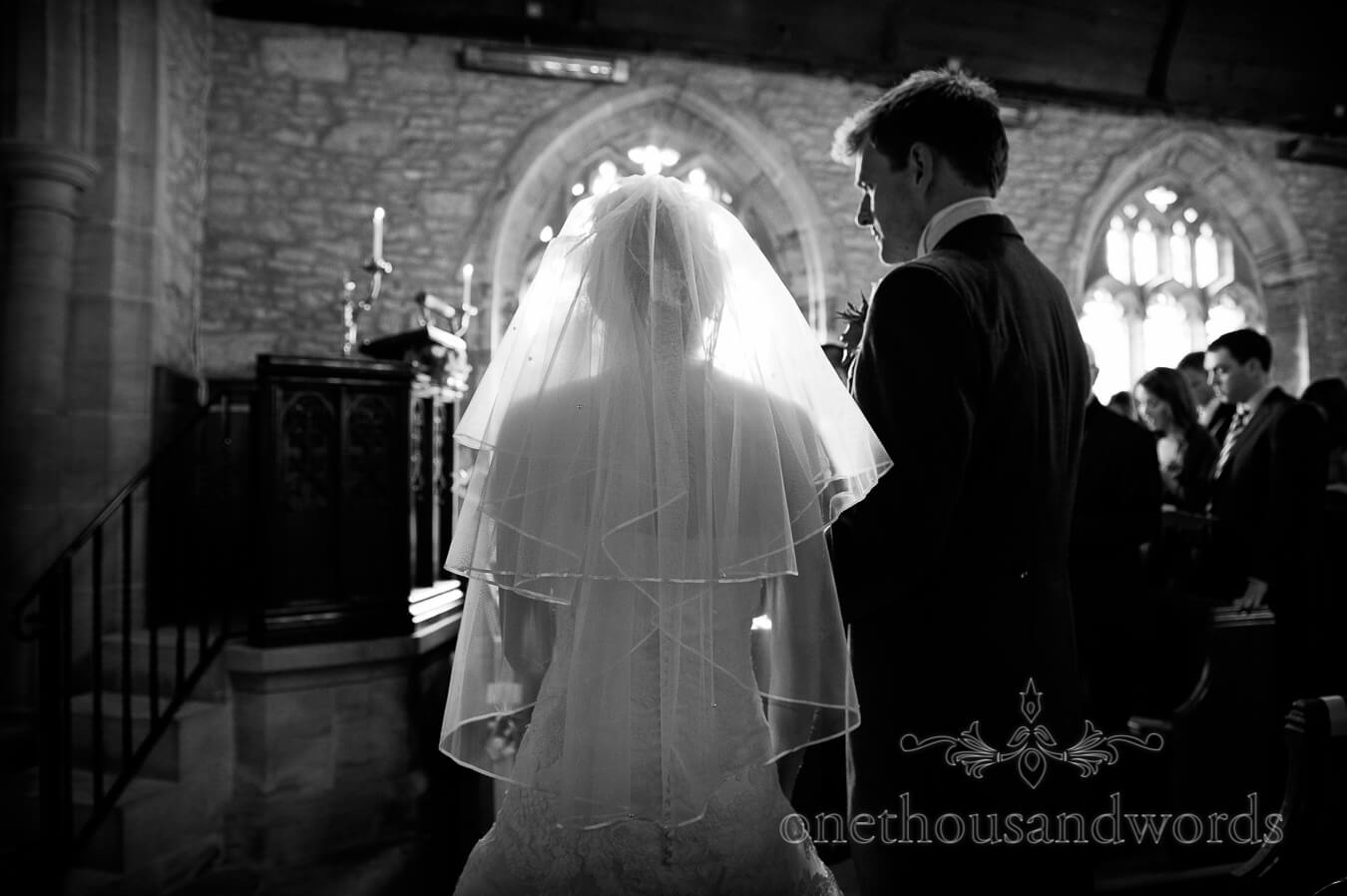 Silouette photograph of bride and groom at church wedding ceremony