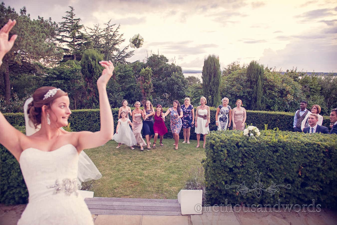Throwing the bouquet at Harbour Heights Hotel, Poole wedding venue