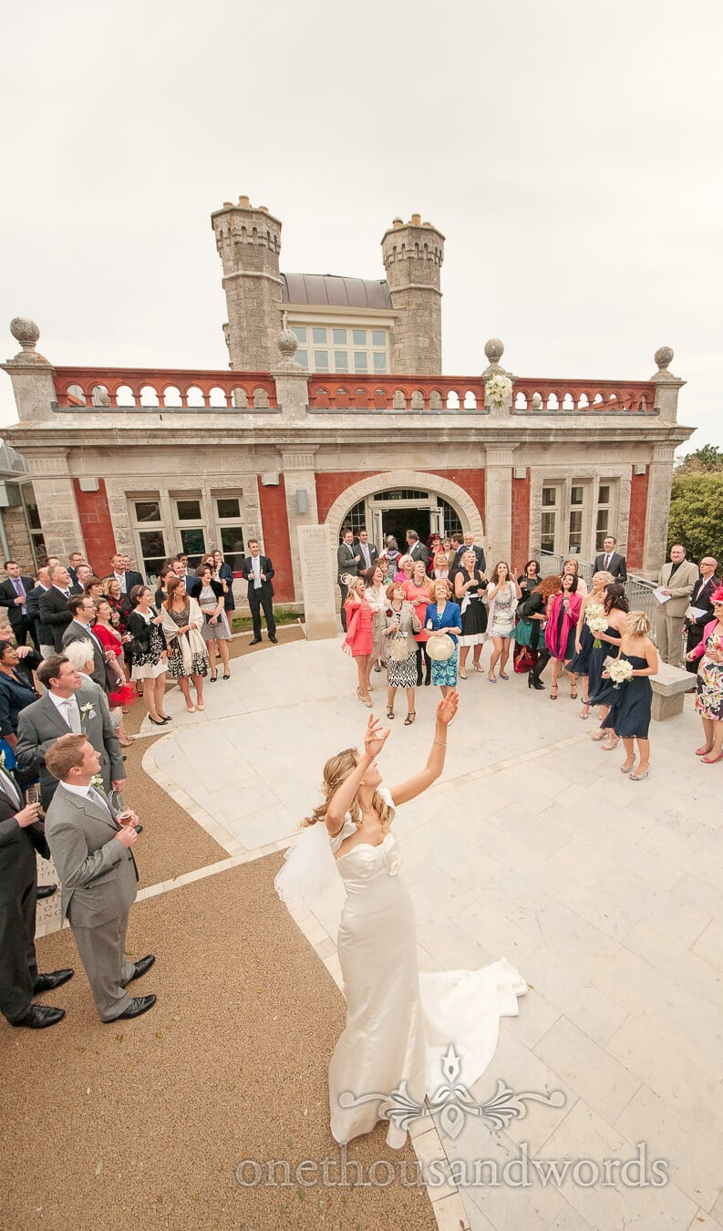 Throwing the wedding bouquet Durlston Castle Wedding Photography