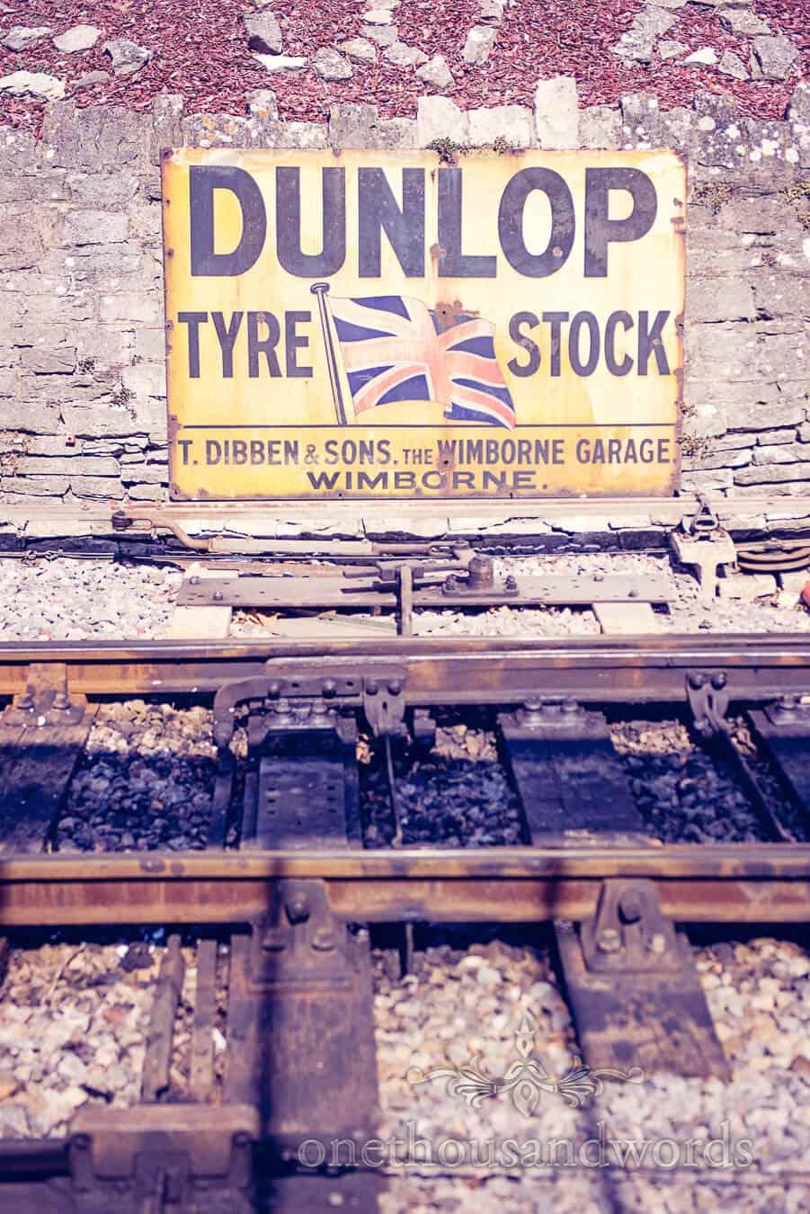 Retro Dunlop Sign at Steam railway station in Dorset