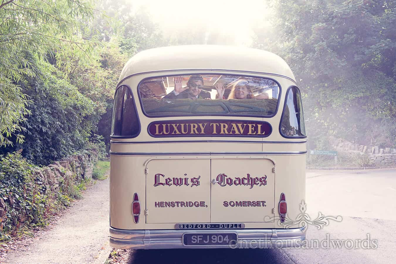 Vintage Style Wedding Bus leaves with waving bride and groom