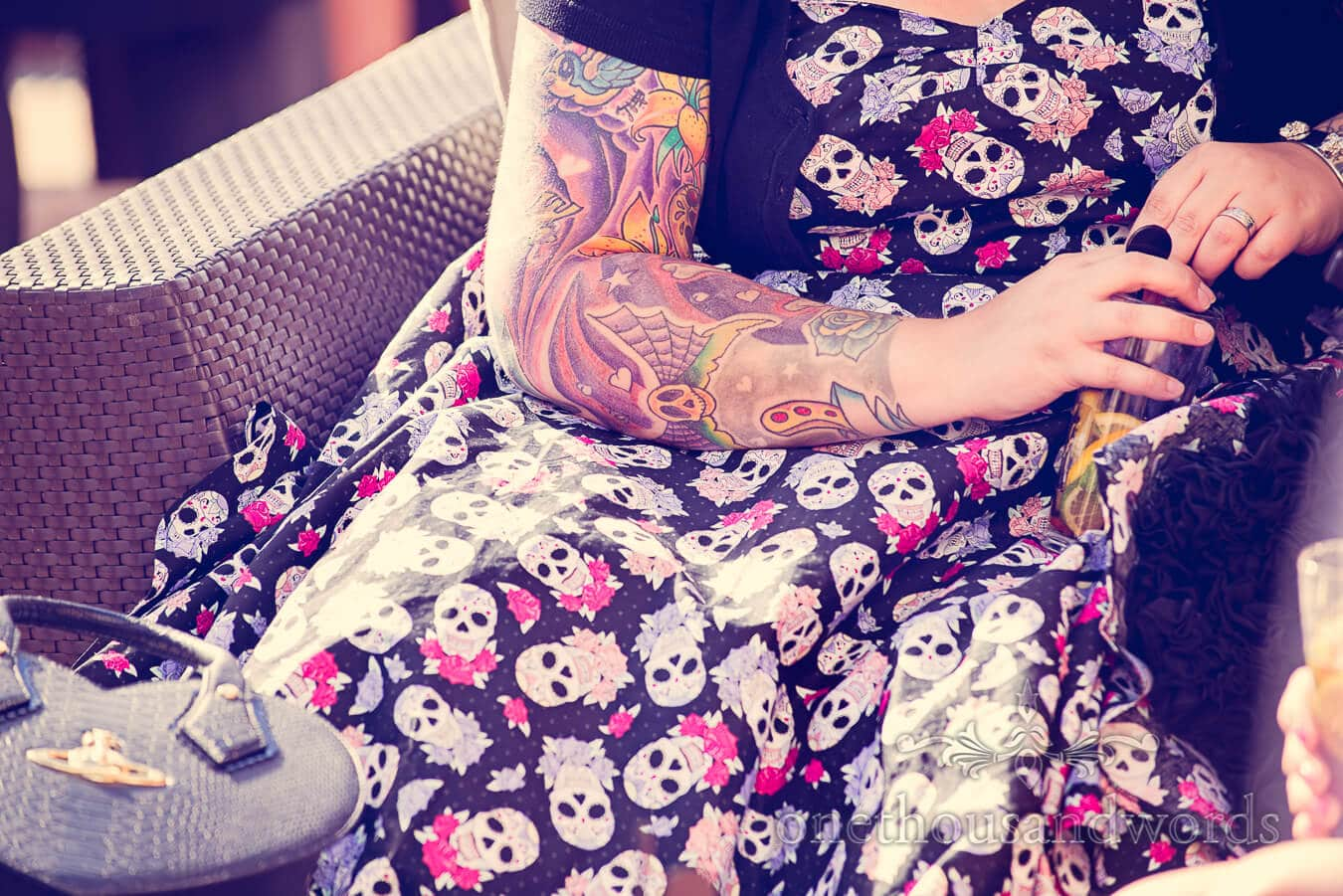 Weddign guest tatoos and sugar skull dress at Poole wedding venue