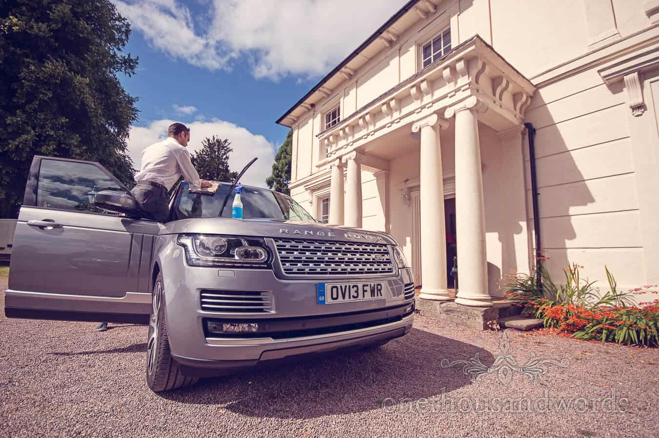 Weddign range rover being cleaned on Countryside Wedding morning