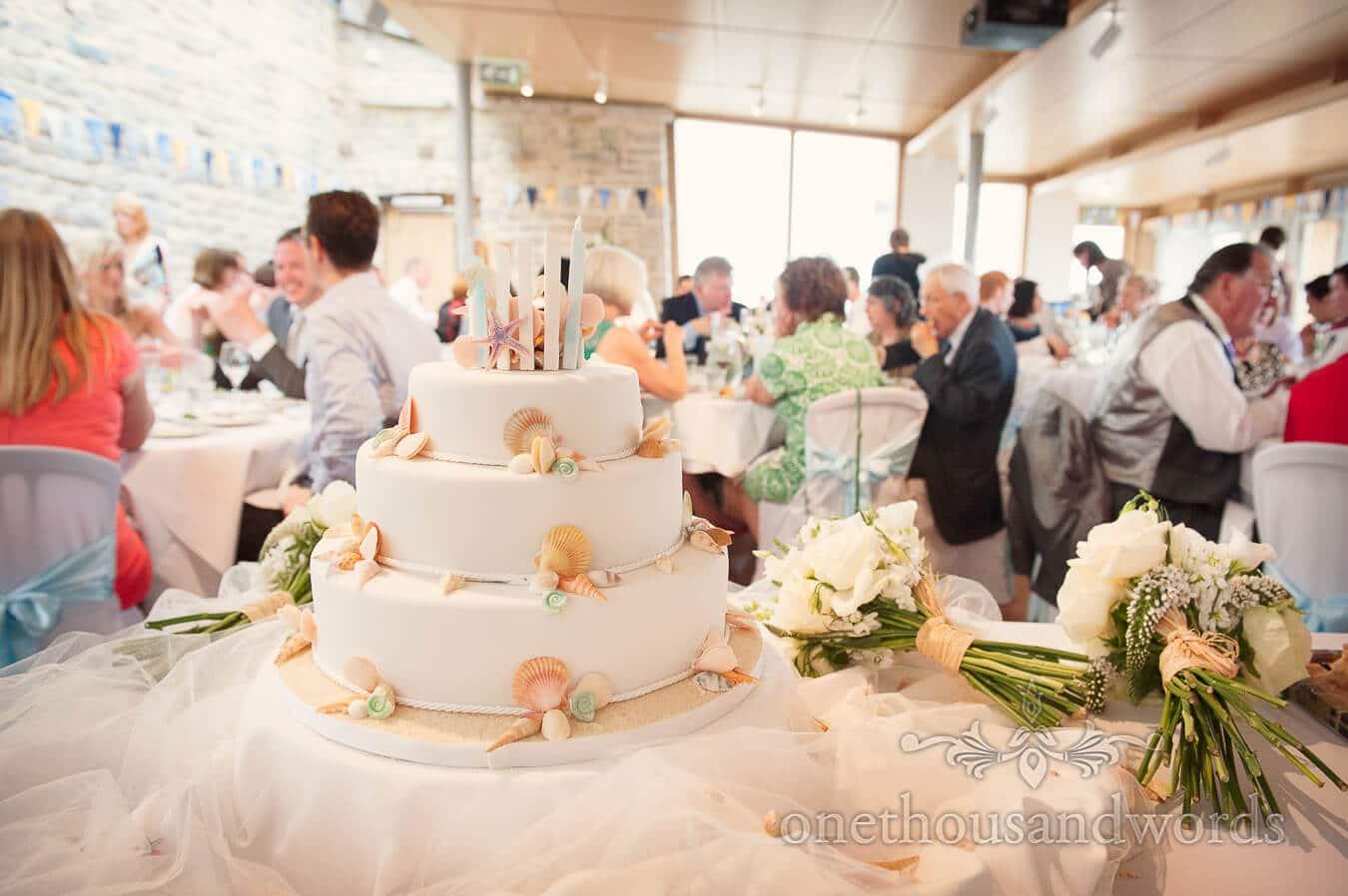 Wedding cake with sea shells at Durlston Castle wedding