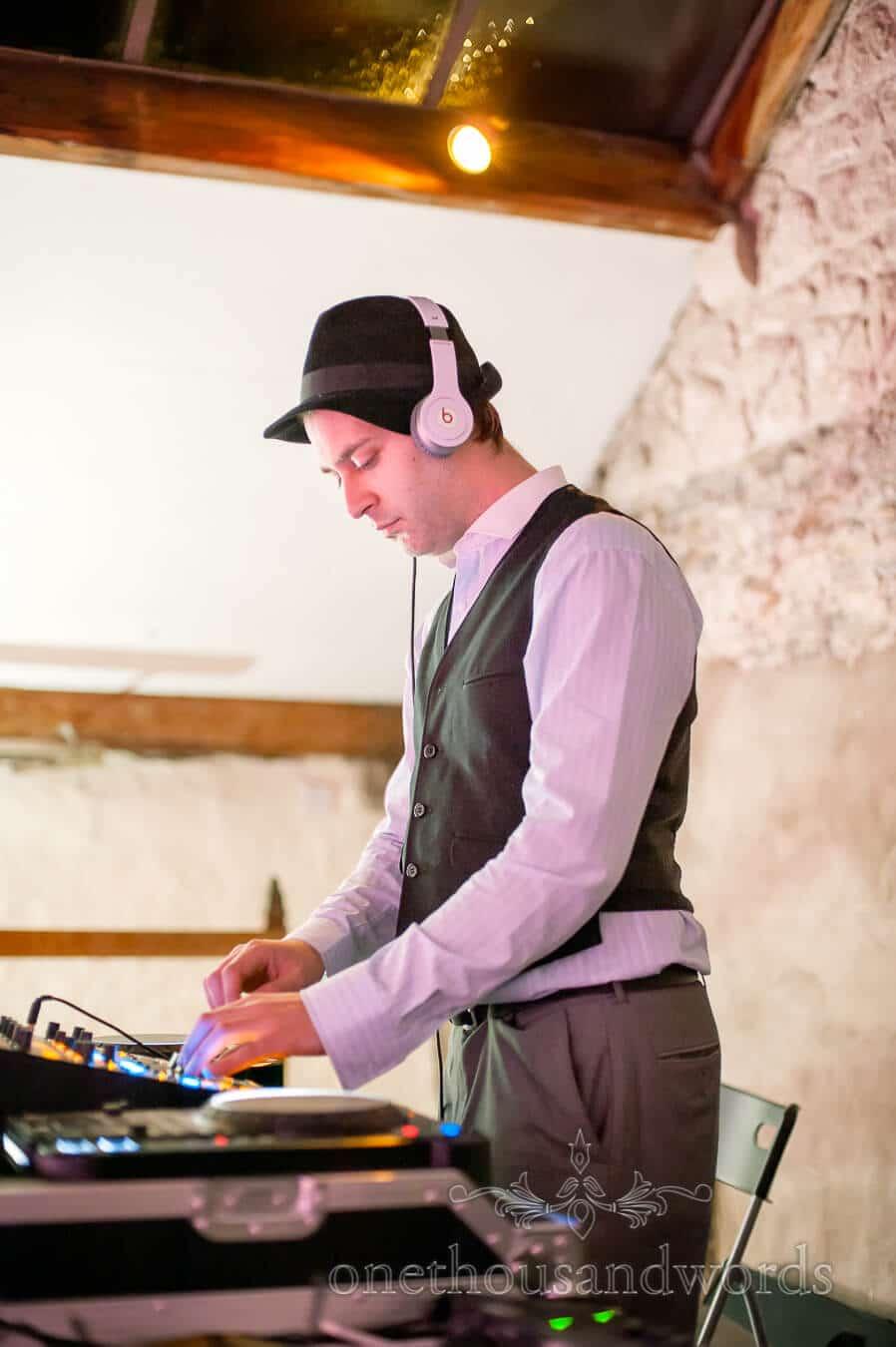 Wedding DJ wearing beats headphones at Prussia Cove Wedding