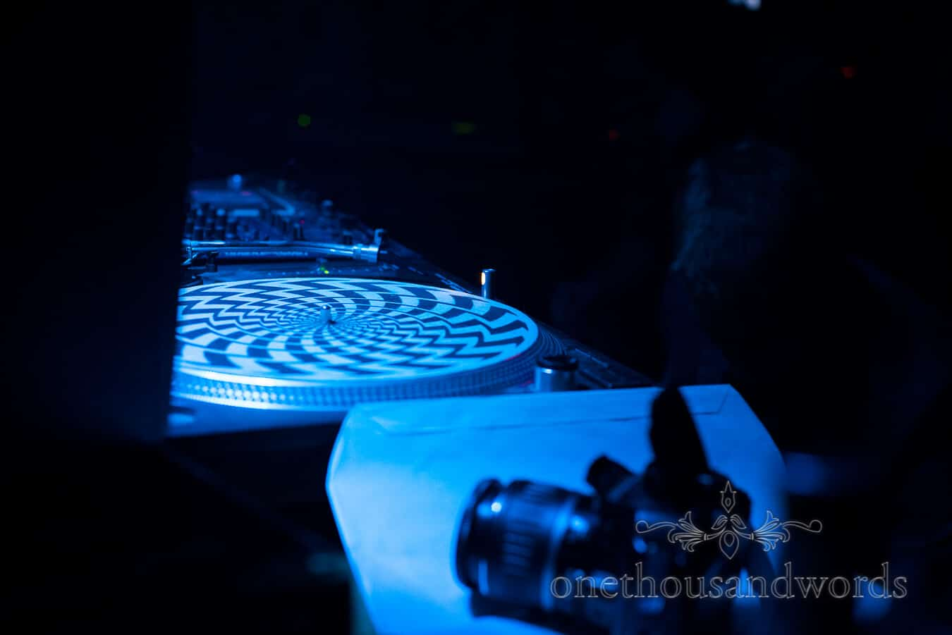Wedding DJ's black and white turntable at countryside wedding venue