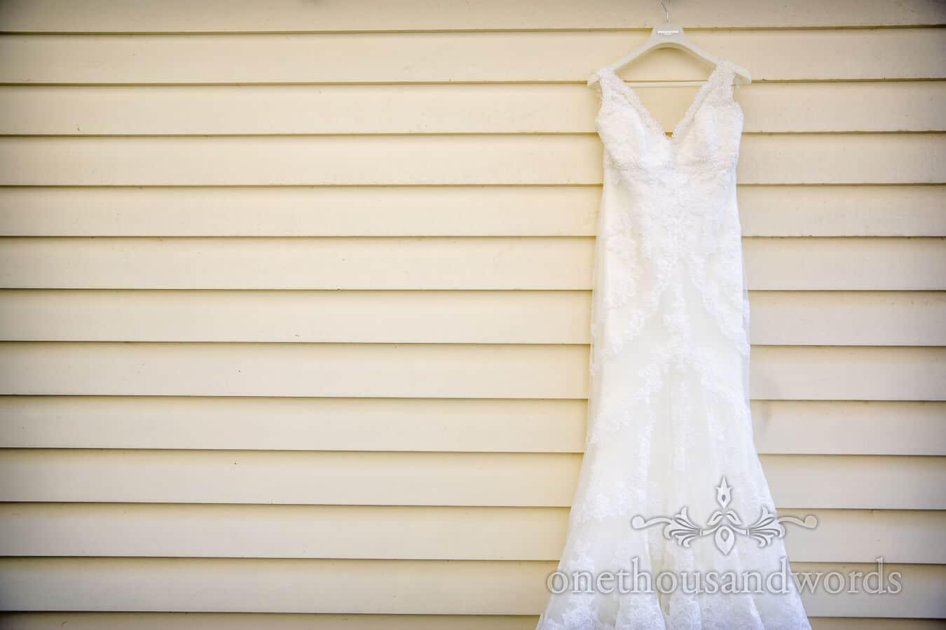 Wedding dress hanging on Hampton Court House Wedding Morning