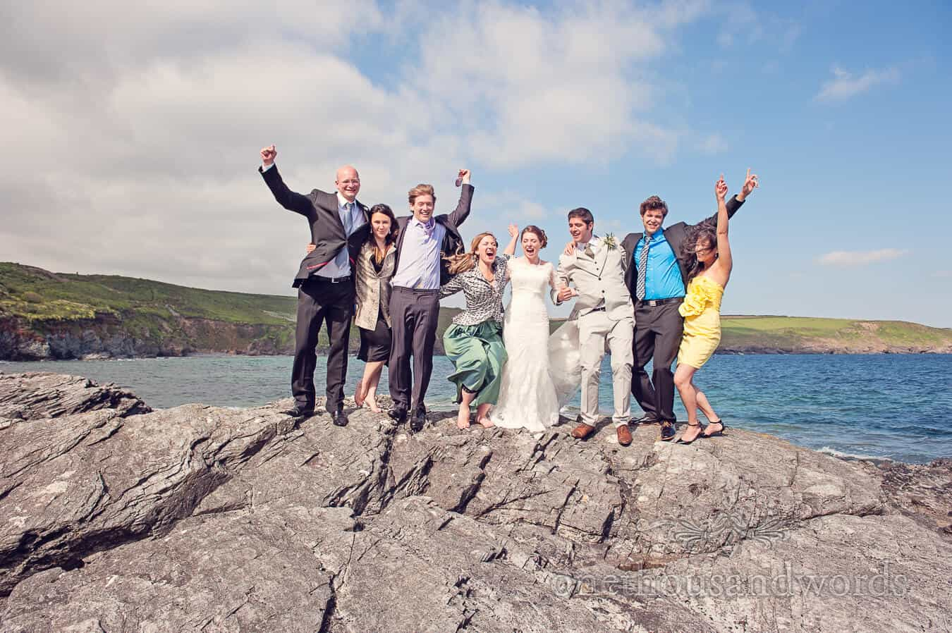 Wedding group photograph by the sea at Prussia Cove Wedding