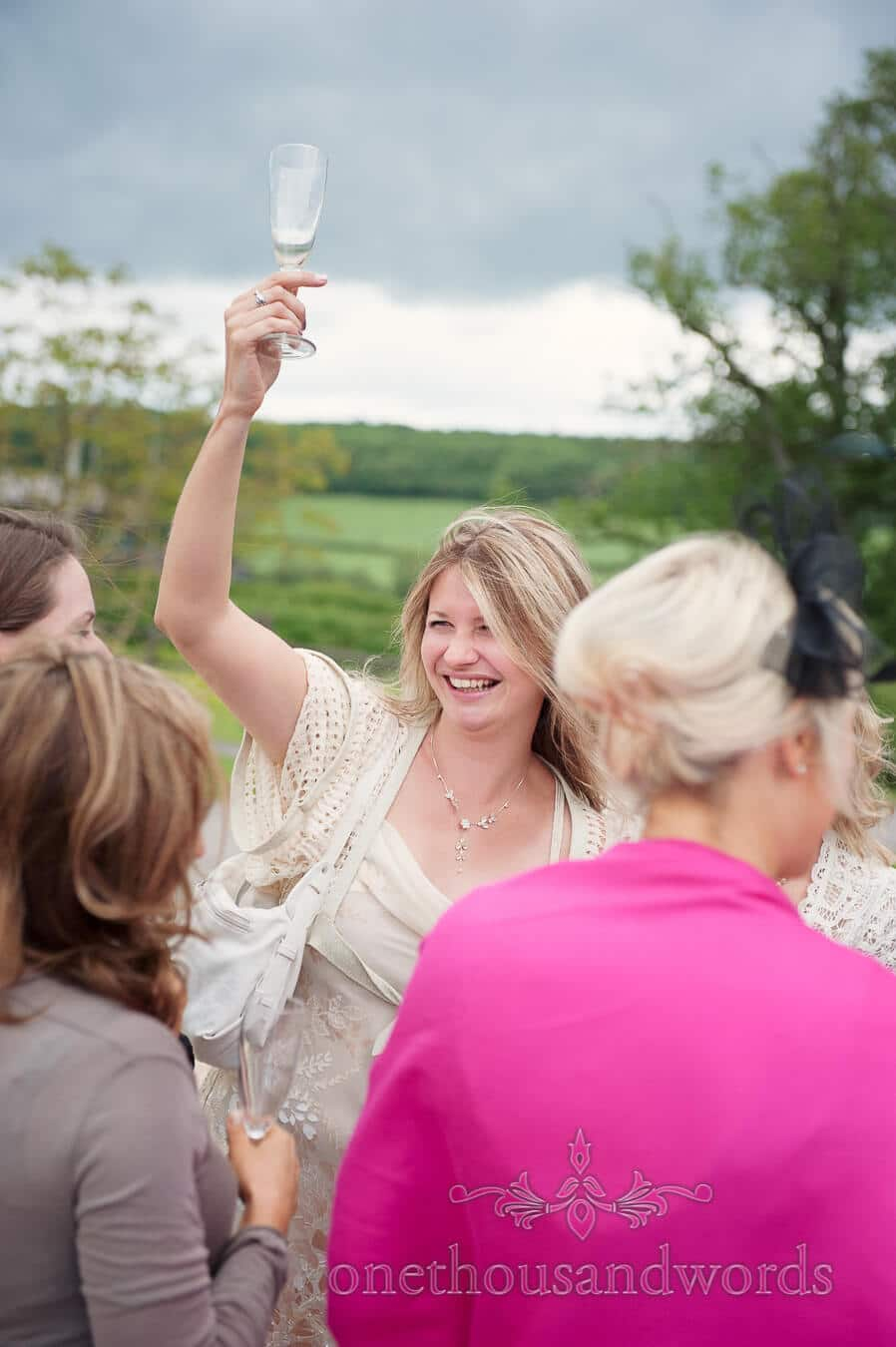 wedding guest celebrates with champagne glass