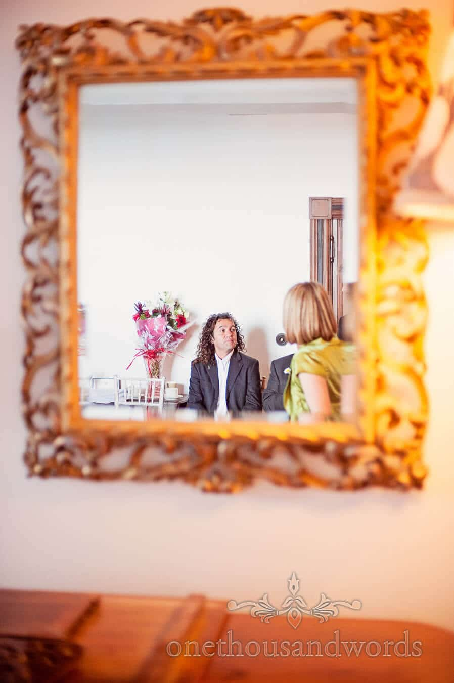 Wedding guest framed in mirror at Prussia Cove Wedding