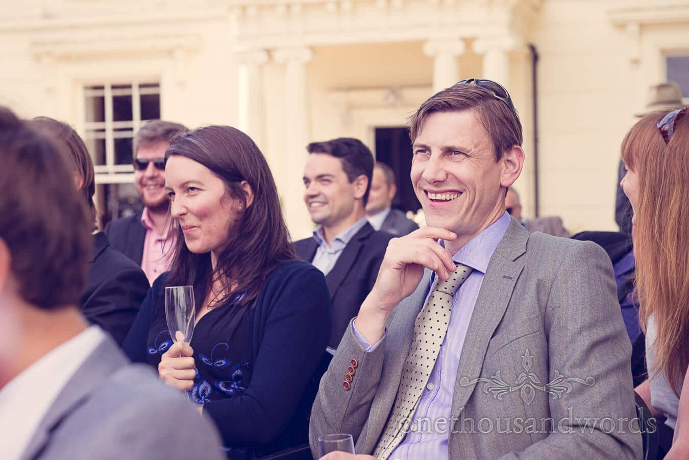 Wedding guest laughs at wedding speeches at Countryside Wedding