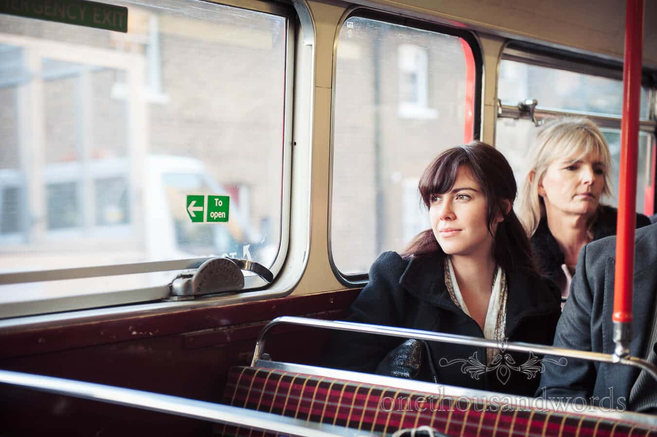 Wedding guest on red london bus wedding transport