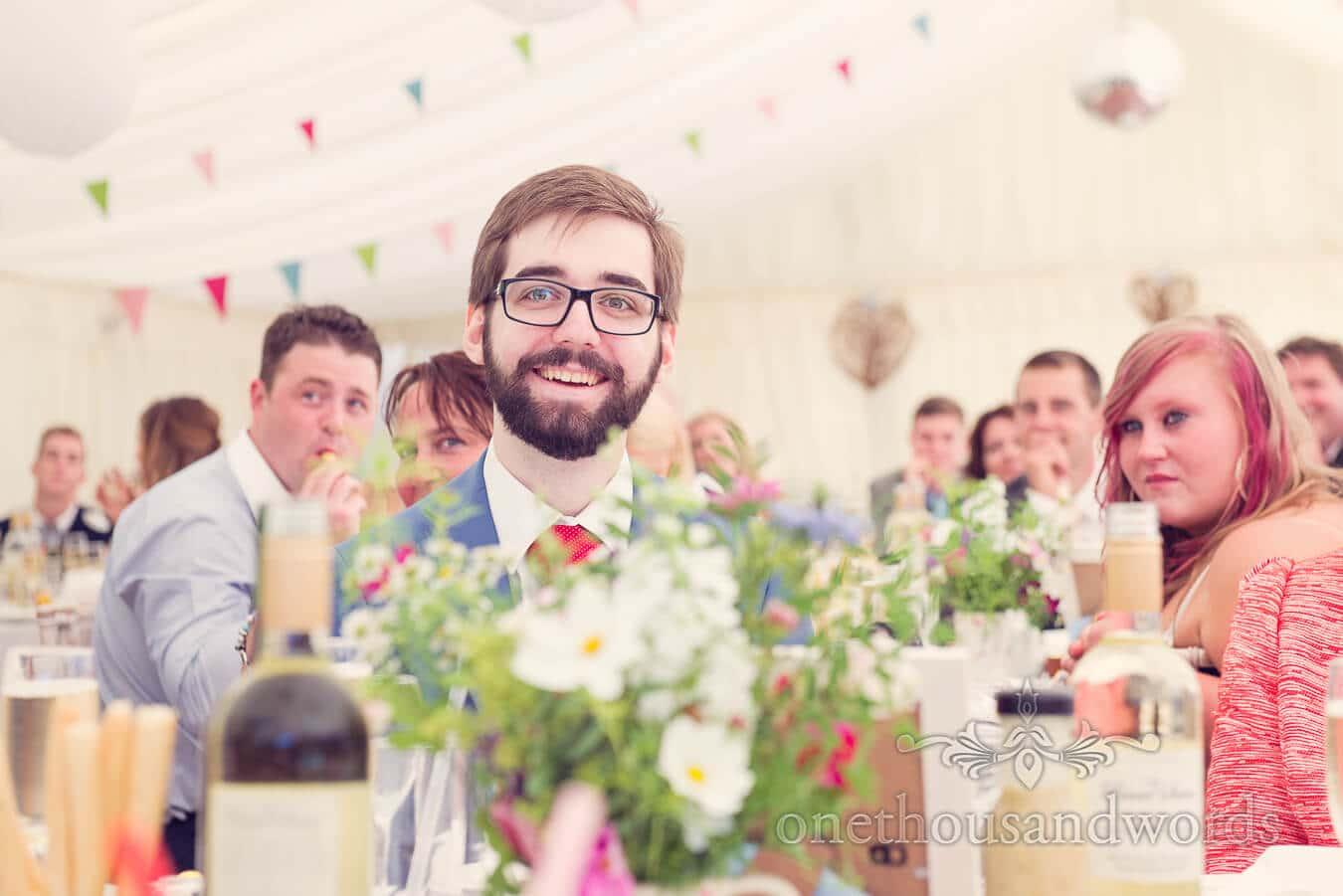 Wedding guest portrait in wedding marquee during wedding speeches