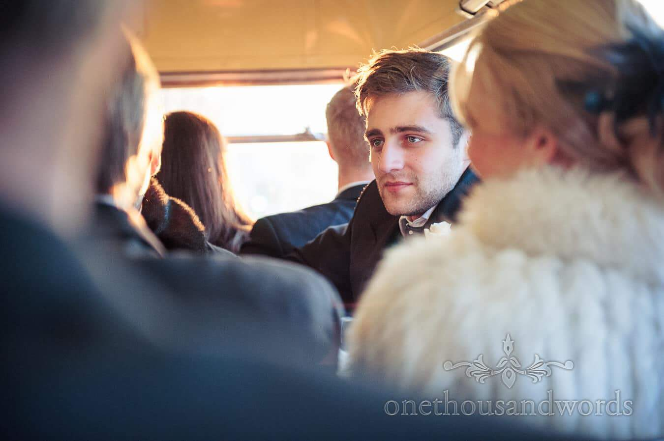 Wedding guest portrait on red London bus wedding transport