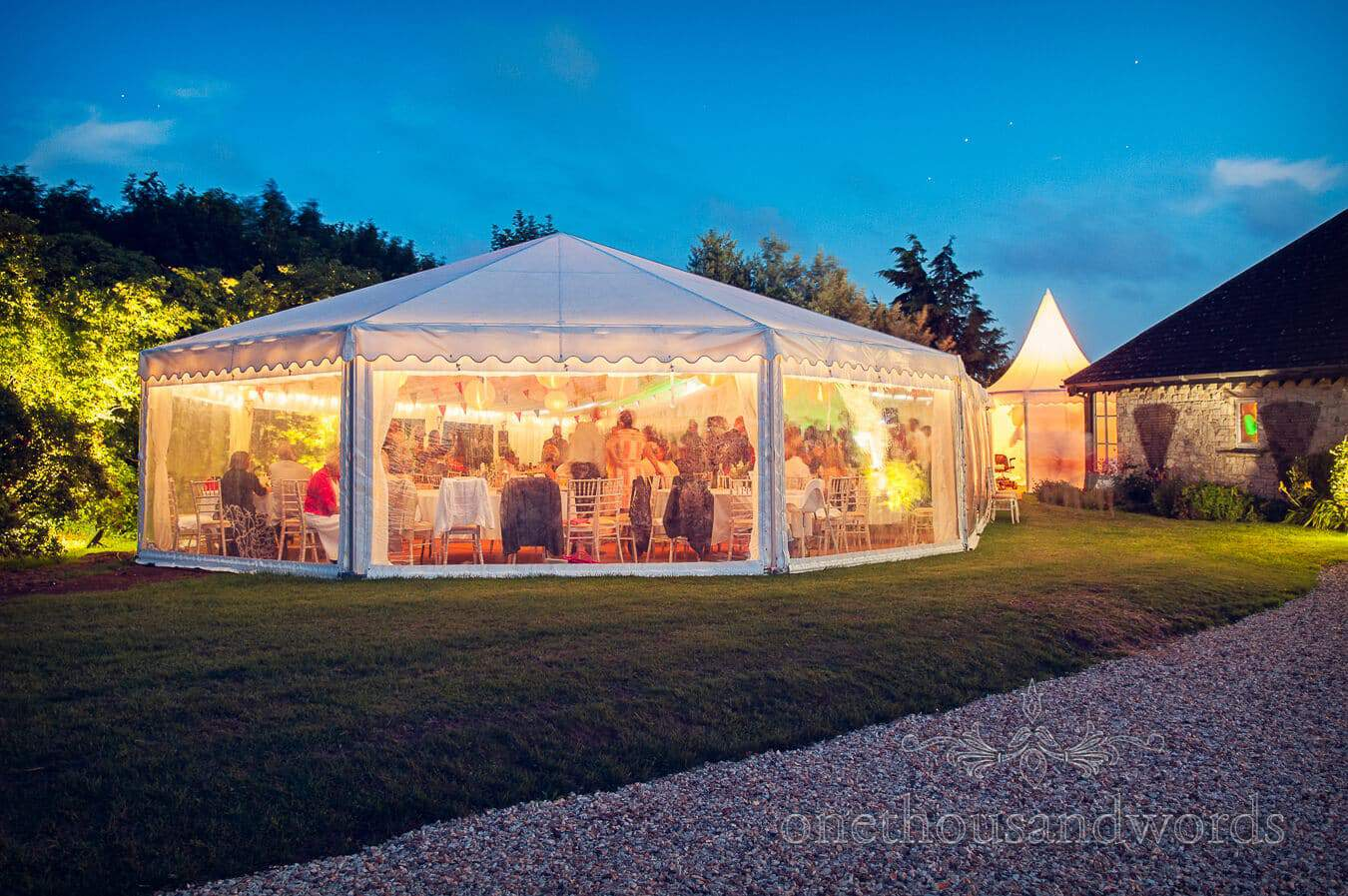 Wedding marquee glowing at night at Dorset Home Wedding