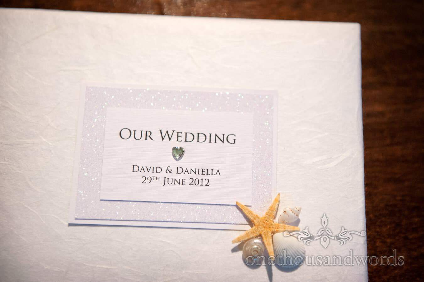 Wedding order of service with sea shells and starfish