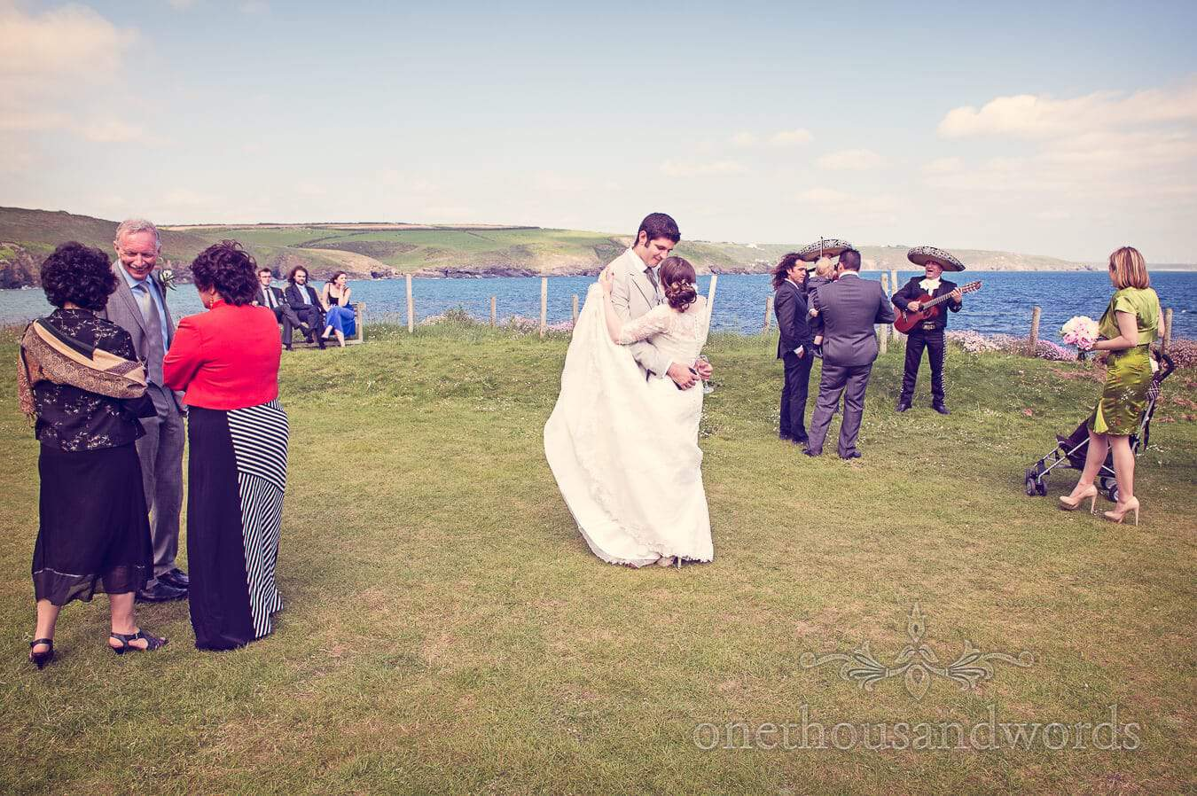 Wedding party enjoy drinks reception at Prussia Cove Wedding