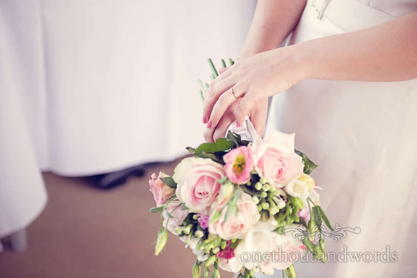 Gold Wedding Ring Photograph with pink wedding flowers