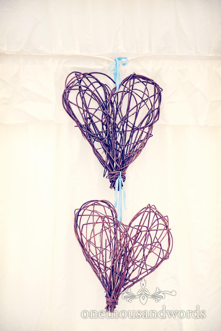 wedding wicker love hearts hanging in wedding marquee