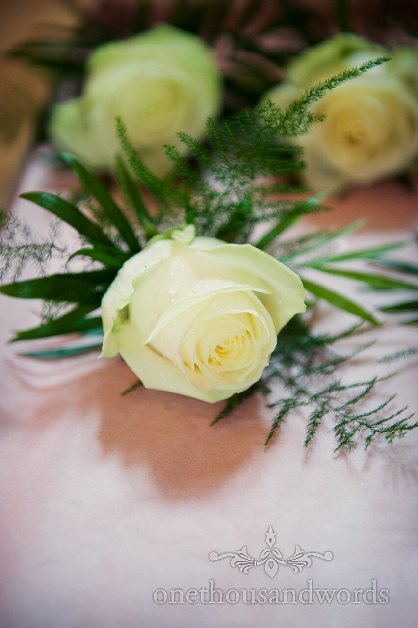 White Rose wedding buttonhole flower at Lord Bute wedding