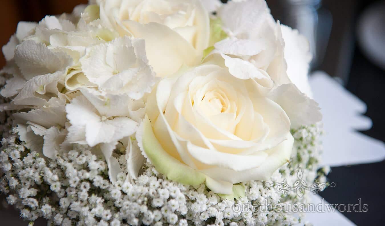 White roses in white flower weddign bouquet
