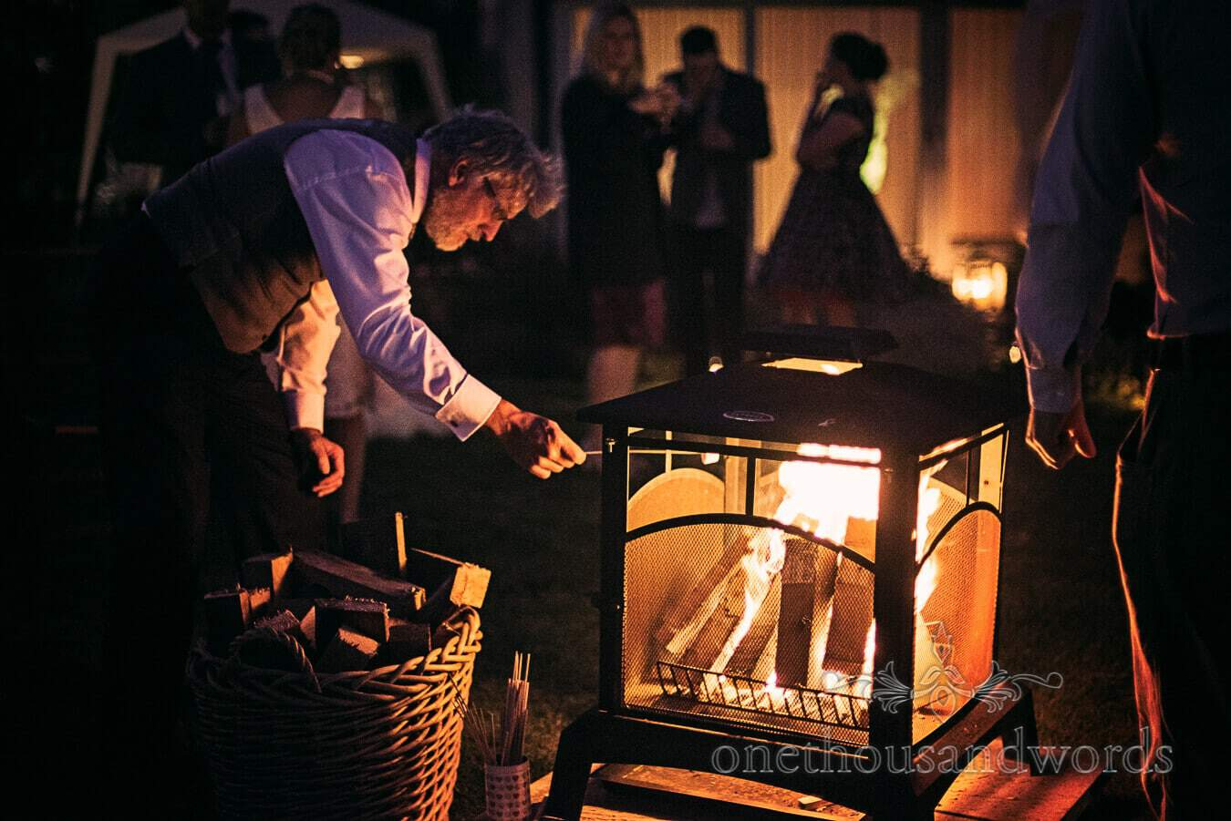 Wood fire is lit at Dorset Home Wedding evening reception