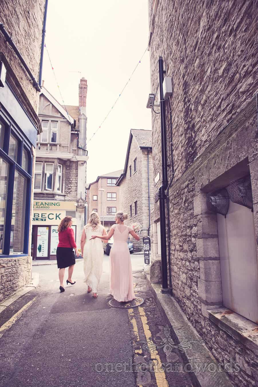 Bride and bridesmaid arrive for Purbeck Golf Club Wedding