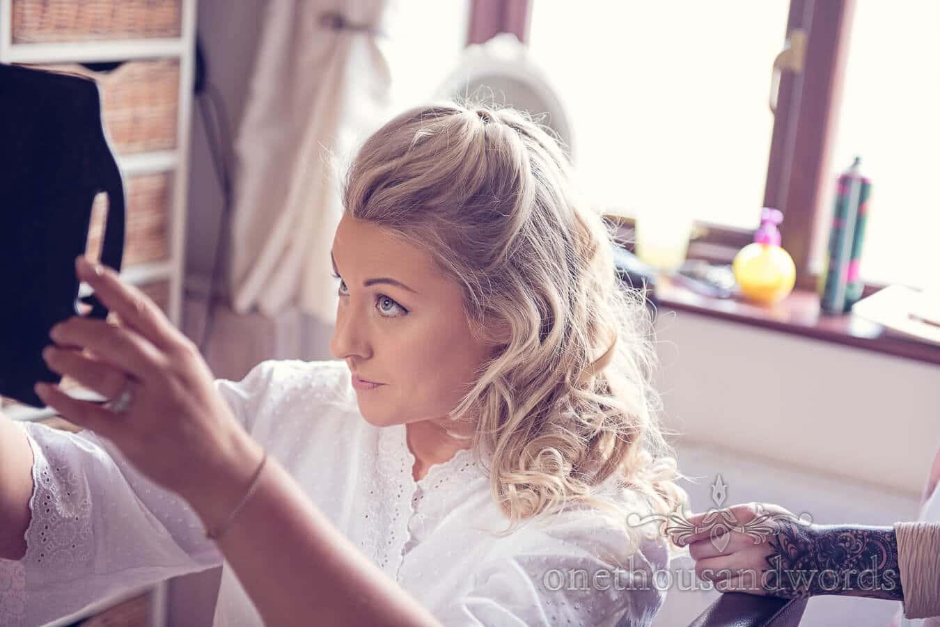 Bride checks in mirror before Purbeck Golf Club Wedding