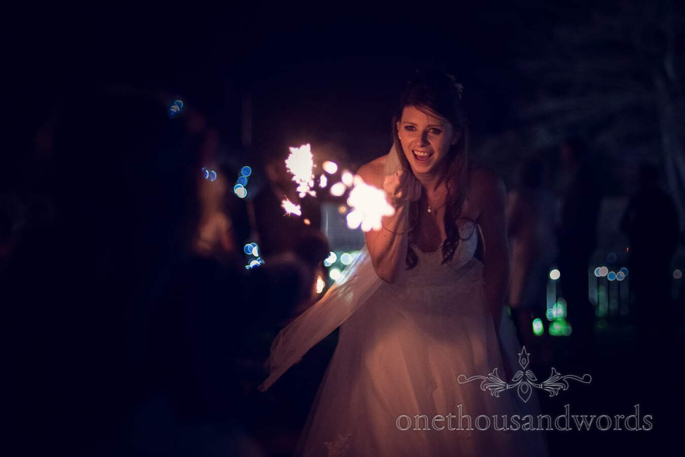 Bride with sparkler from wedding at Sopley Mill