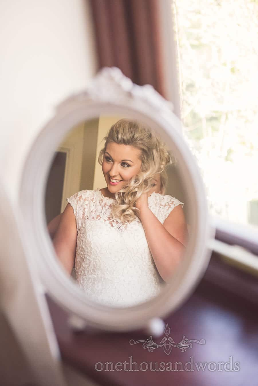 Brides hair adjusted before Purbeck Golf Club Wedding