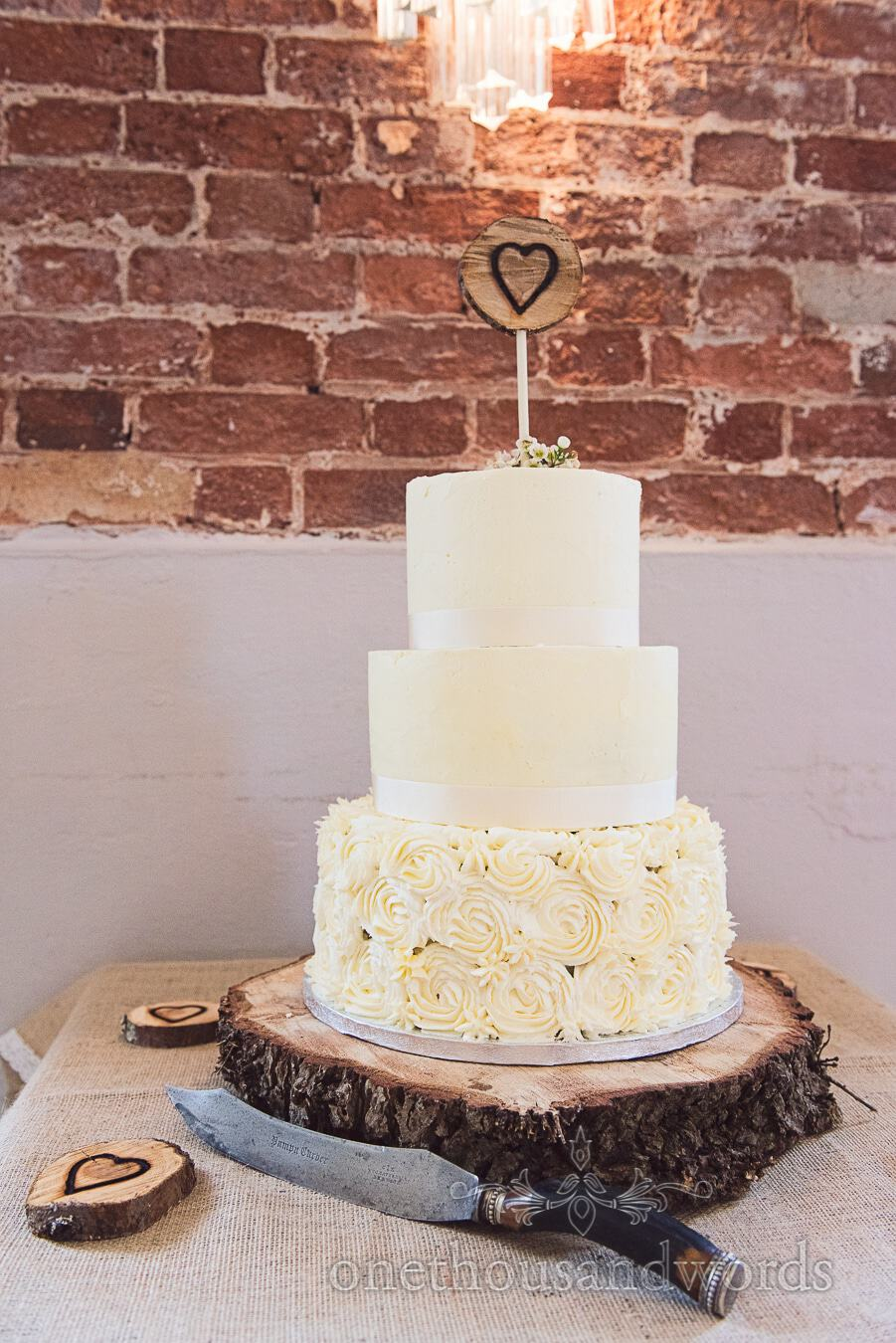 Cake on wood block base from wedding at Sopley Mill