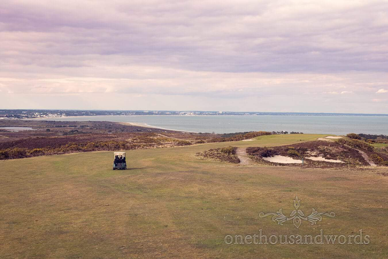 Couple in a buggy on the 5th fairway at Purbeck Golf Club Wedding